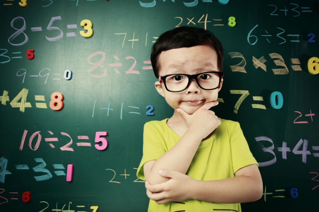 cute asian kid doing math